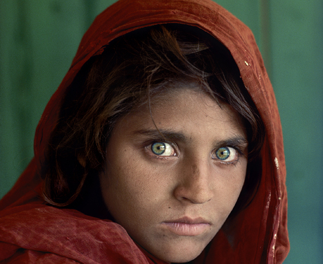 "Sharbat Gula, Afghan Girl, at Nasir Bagh refugee camp near Peshawar, Pakistan, 1984. National Geographic Magazine, Vol. 167, No. 6, June 1985, Along Afghanistan's War-torn Frontier. ""The green-eyed Afghan girl became a symbol in the late twentieth century of strength in the face of hardship. Her tattered robe and dirt-smudged face have summoned compassion from around the world; and her beauty has been unforgettable. The clear, strong green of her eyes encouraged a bridge between her world and the West. And likely more than any other image, hers has served as an international emblem for the difficult era and a troubled nation."" - Phaidon 55 The iconic image does not stand outside of time. Rather, it connects with the moment in a deeply profound way. Such as images are imbued with meaning, a significance that resonates deeply with a wide and diverse audience. McCurry's photograph of the Afghan girl is one such image. For many, this beautiful girl dressed in a ragged robe became a worldwide symbol for a nation in a state of collapse. Haunted eyes tell of an aAfghan refugee's fears. Bannon, Anthony. (2005). Steve McCurry. New York: Phaidon Press Inc., 12. NYC5958, MCS1985002 K035 Afghan Girl: Found National Geographic, April 2002 Phaidon, Iconic Images, final book_iconic, page 33. National Geographic Magazine, Along Afghanistan's War-torn Frontier, June 1985, Vol. 167, No. 6 South Southeast_Book In the Shadow of Mountains_Book Steve Mccurry_Book Looking East_Book Iconic_Book Untold_book PORTRAITS_APP final print_MACRO final print_Sao Paulo final print_Milan final print_Birmingham Retouched_ Sonny Fabbri 03/04/2015"